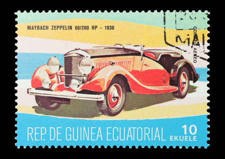 equatorial guinea: Equatorial Guinea - circa 1974: Commemorative mail stamp printed in Equatorial Guinea featuring a vintage 1936 Maybach Zeppelin sports car. Editorial