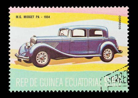 midget: Equatorial Guinea - circa 1974: Commemorative mail stamp printed in Equatorial Guinea featuring a vintage 1934 MG Midget PA car.