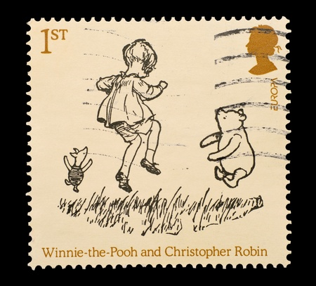 UNITED KINGDOM - CIRCA 2010: Commemorative mail stamp printed in the UK featuring A.A. Milnes Winnie The Pooh, Christopher Robin and Piglet characters, circa 2010