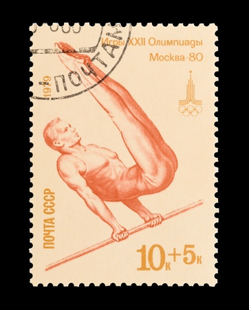 olympic sports: USSR (CCCP) - circa 1979: Moscow 1980 Olympics commemorative mail stamp featuring a male gymnast.