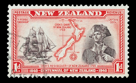 New Zealand - 1940: Mail stamp printed in New Zealand featuring a portrait of Captain Cook, the H.M Bark Endeavour and maritime chart of the islands.