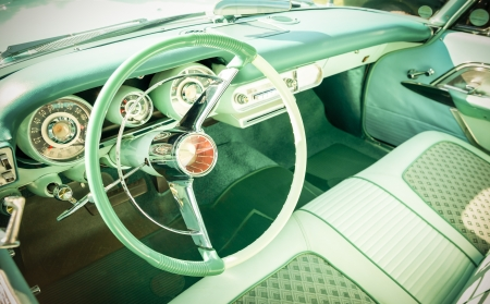 retro styled vehicle dashboard and steering wheel photo