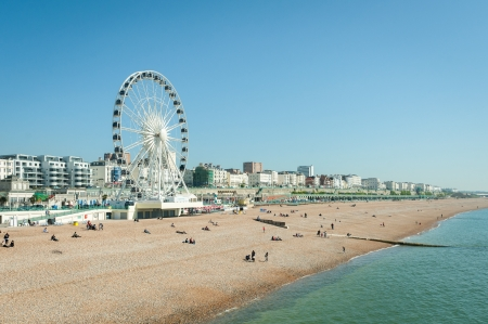 clear blue sky over Brighton beach, UK and the tourist attractions of Madeira Drive