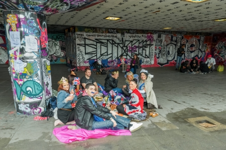 London, UK - June 3, 2012: Yound adults enjoying a picnic amongst the urban art on the South Bank during the Queen Elizabeth II Diamond Jubilee celebrations.