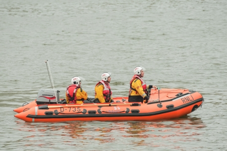 lifeboats: London, UK - June 3, 2012: RNLI lifeboat crew on duty at the Queen Elizabeth II Diamond Jubilee Pageant on the River Thames, UK