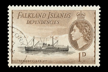 queen elizabeth ii: Falkland Islands - circa 1954: Mail stamp printed in the Falkland Islands featuring the Antarctic supply ship, Trepassey.