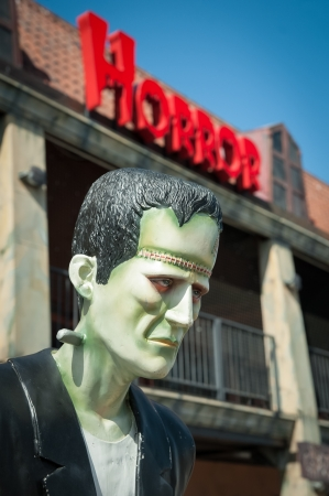 Frankenstein mannequin with horror sign above its head