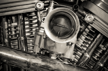 carburettor: sepia toned cromed motorcycle engine detail