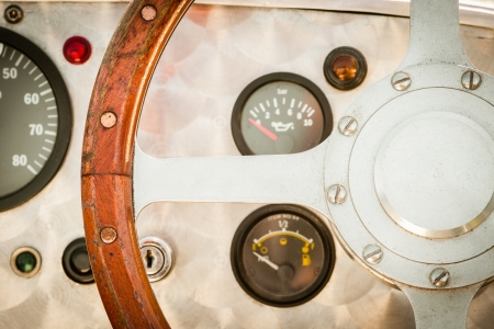 steering wheel detail of a vintage sports car
