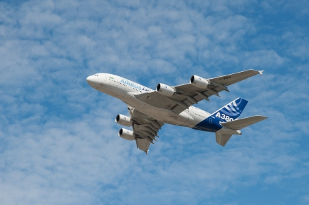 Farnborough, UK - July 16, 2010: Large Airbus A380 passenger aircraft just after take-off from Farnborough Airport, UK