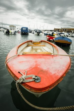 small rowboat in a busy harbor photo