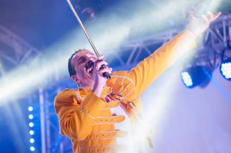 showmanship: Yateley, UK - June 30, 2012: Professional Freddie Mercury tribute artist Steve Littlewood performing at the GOTG Festival in Yateley, UK Editorial