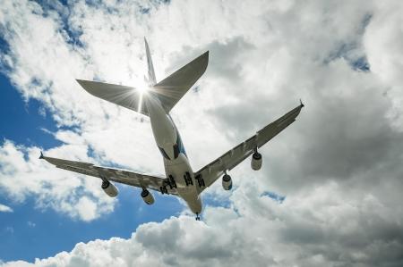 airshow: Farnborough, UK - July 10, 2012: Landing approach of an Airbus A380 passenger jet, part of the international airshow display at Farnborough, UK Editorial