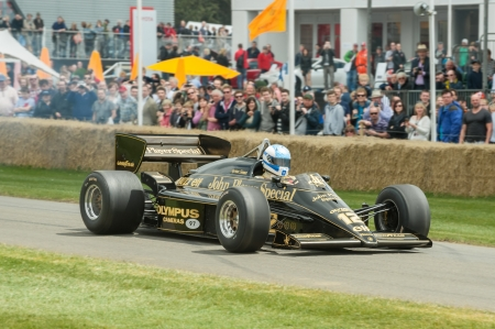 Goodwood, UK - July 1, 2012: Tom Kristensen driving the classic Ayrton Senna JPS Lotus F1 racing car on the hill course at Goodwood, UK Stock Photo - 14418977