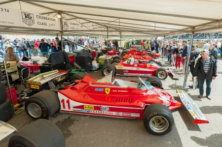 ferrari: Goodwood, UK - July 1, 2012: Collection of classic Ferrari F1 racing cars in the service pits at the Festival of Speed motor sport event held at Goodwood, UK Editorial