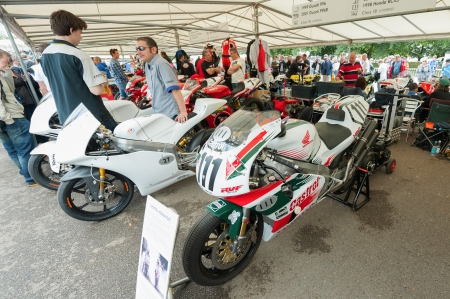 pits: Goodwood, UK - July 1, 2012: Classic Honda and Ducati racing bikes in the service pits at the Festival of Speed motor sport event held at Goodwood, UK