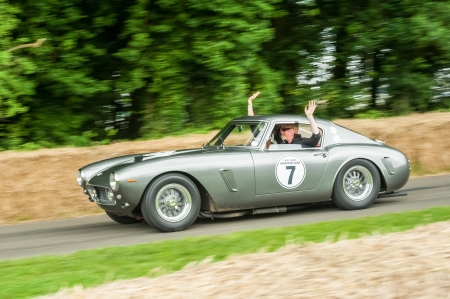 Goodwood, UK - July 1, 2012: British TV and radio personality Chris Evans driving a classic Ferrari 250 SWB at the Festival Of Speed, Goodwood, UK