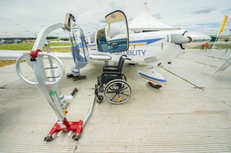 wheelchair access: Farnborough, UK - July 12, 2012: Equipment used by the UK Aerobility charity to assist pilots with disabilities, on display at the Farnborough Airshow, UK Editorial