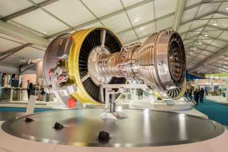 Farnborough, UK - July 12, 2012: Exhibition stands displaying large jet engines and other components used in the aviation industry at the Farnborough International Airshow, UK