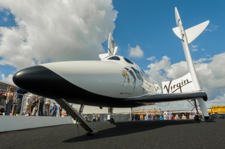 Farnborough, July 15, 2012: The futuristic Virgin Galactic reuseable, sub-orbital spacecraft on static display at the Farnborough International Airshow, UK