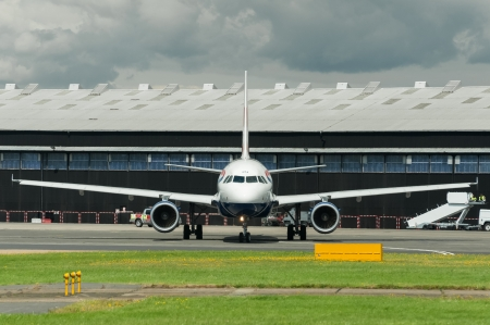 airways: Farnborough, UK - July 15, 2012: British Airways Airbus A318 taxiing on to the runway at Farnborough International Airshow, UK Editorial