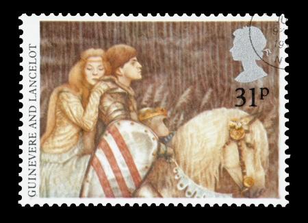 연합 왕국: United Kingdom - circa 1985: Mail stamp printed in the UK featuring the Arthurian Legends of Lady Guinevere and Sir Lancelot.