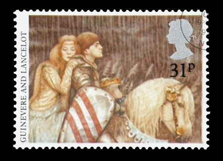 arthur: United Kingdom - circa 1985: Mail stamp printed in the UK featuring the Arthurian Legends of Lady Guinevere and Sir Lancelot.