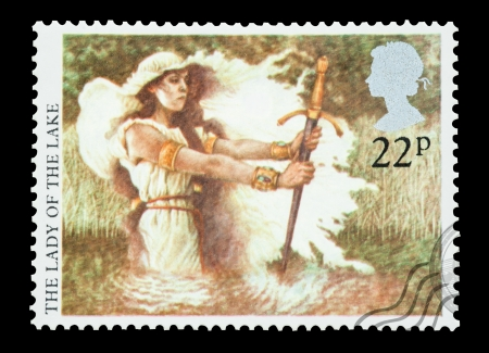 arthur: United Kingdom - circa 1985: Mail stamp printed in the UK featuring the Arthurian Legend Lady Of The Lake with the excalibur sword.