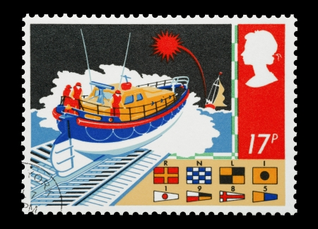 rescue service: United Kingdom - circa 1985: Mail stamp printed in the UK depicting the work of the British RNLI maritime rescue service. Editorial
