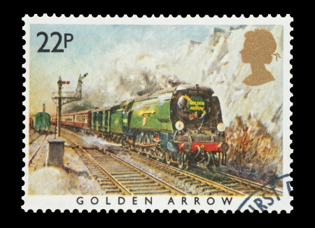 Mail stamp printed in the UK featuring the British built Golden Arrow steam locomotive, circa 1985 Stock Photo