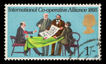 co operative: Commemorative mail stamp printed in the UK featuring the signing of the International Co-operative Alliance, circa 1970