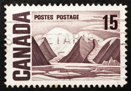canada stamp: Mail stamp printed in Canada featuring a rocky mountain landscape, circa 1967 Editorial