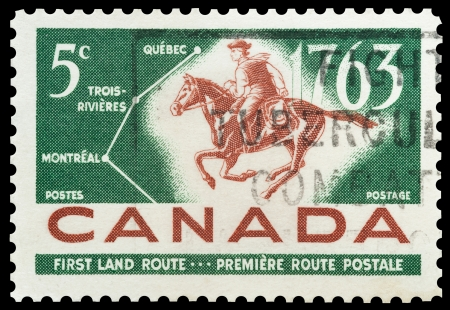 canada stamp: Commemorative mail stamp printed in Canada celebrating the bicentiale of the Montreal-Quebec mail route, circa 1963