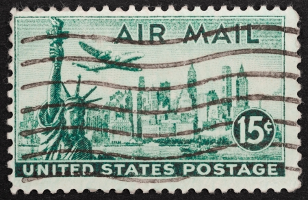 Air mail stamp printed in the USA featuring the New York city skyline, circa 1947