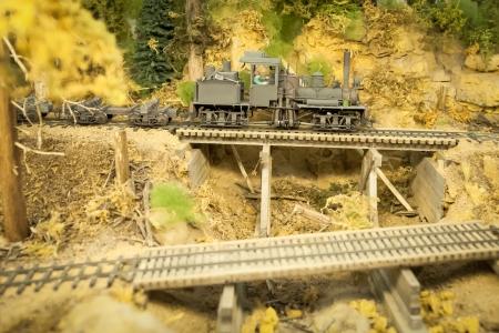 locomotion: model vintage steam locomotive on a downhill gradient Stock Photo