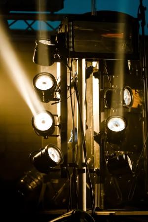 multiple spotlights on a stage lighting rig photo