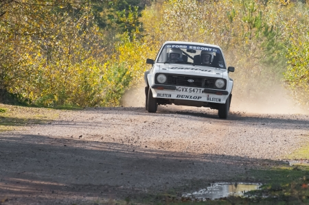 Aldershot, UK - November 3, 2012: Ernie Graham driving a classic Ford Escort RS on the Pavillion stage of the MSA Tempest Rally near Aldershot, UK Stock Photo - 16223408
