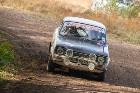 cornering: Aldershot, UK - November 3, 2012: Mike Hall driving a classic Ford Escort Mexico on the Pavillion stage of the MSA Tempest Rally near Aldershot, UK