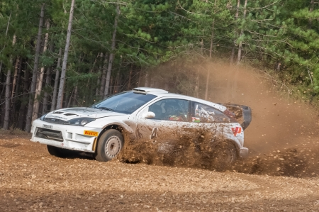 rally car: Bramshill Forest, UK - November 3, 2012: Jason Pritchard driving a WRC spec Ford Focus on the Warren stage of the MSA Tempest Rally in Bramshill Forest, UK Editorial