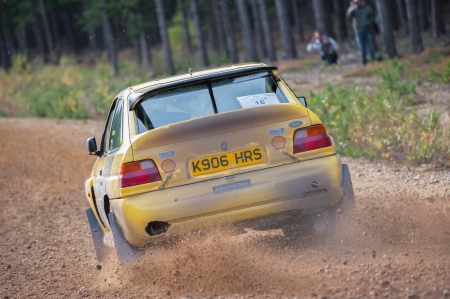 wheelspin: Bramshill Forest, UK - November 3, 2012: Tony Bird driving a Ford Escort Cosworth on the Warren stage of the MSA Tempest Rally in Bramshill Forest, UK