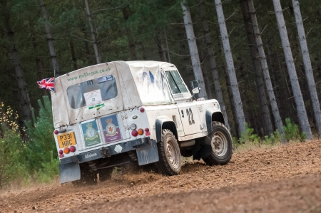 wheelspin: Bramshill Forest, UK - November 3, 2012: RAF military team driver Flt. Lt. Steve Partridge in a Land Rover Wolf on the Warren stage of the MSA Tempest Rally in Bramshill Forest, UK