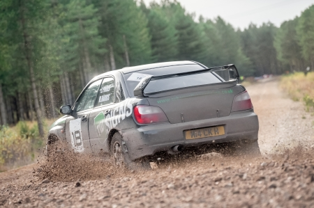 Bramshill Forest, UK - November 3, 2012: Over-steer by Mike Harris driving a Subaru Impreza on the Warren stage of the MSA Tempest Rally in Bramshill Forest, UK