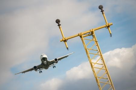 landing light: passenger jet on a flightpath to an airport