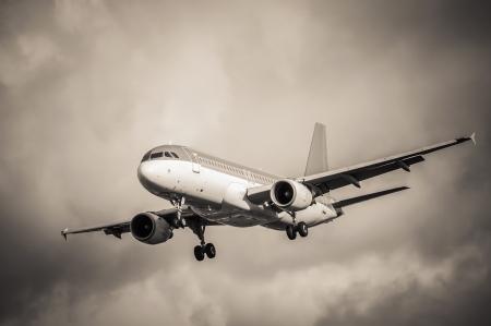turbulence: sepia toned passenger aircraft landing in turbulence Stock Photo