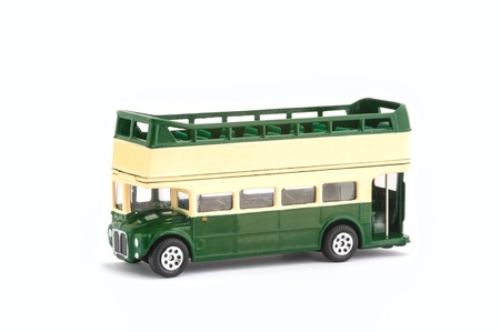 miniature scale model of a vintage open top tour bus on white with copy-space photo