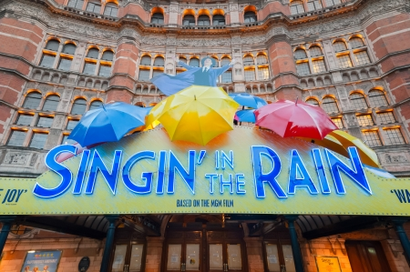 westend show: London, UK - January 27, 2013: Exterior lights warming the Palace Theatre windows for an evening performance of the hit musical stage version of Singing In The Rain in West End of London, UK