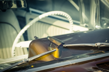 windshield and steering wheel on a retro styled vehicle photo