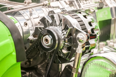 chromed vehicle alternator in a hot-rod engine bay photo