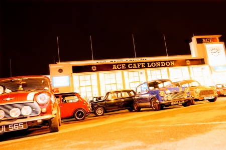 motorcar: London, UK - April 4, 2013: Night exposure of a collection of classic Austin Mini automobiles outside at the landmark Ace Cafe