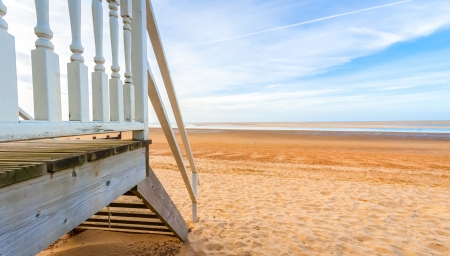 sunsets: horizon view from a beach hut at low tide Stock Photo